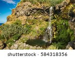 small waterfall in the island... | Shutterstock . vector #584318356