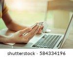 online payment woman's hands... | Shutterstock . vector #584334196