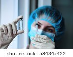 health worker dials the vaccine ... | Shutterstock . vector #584345422