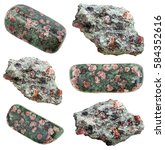 Small photo of collection of various tumbled and raw Eclogite mineral stones with garnet (red almandine, pyrope) in omphacite (greyish-green) matrix isolated on white background