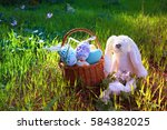 white cute bunny in the basket... | Shutterstock . vector #584382025
