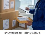 close up image of mail worker... | Shutterstock . vector #584392576