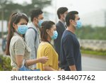 people wearing face masks... | Shutterstock . vector #584407762