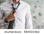 close up of man adjusting his... | Shutterstock . vector #584431462
