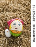 easter egg lies on hay   Shutterstock . vector #584435446
