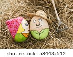 two easter eggs lie in the hay   Shutterstock . vector #584435512