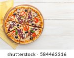 fresh pizza in a rustic italian ... | Shutterstock . vector #584463316