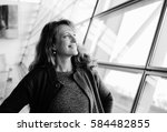 portrait of 40 years old woman | Shutterstock . vector #584482855