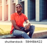 a positive black male dressed... | Shutterstock . vector #584486422