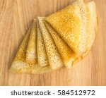 thin pancakes on a wooden... | Shutterstock . vector #584512972