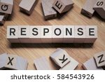 Small photo of Response Word Written In Wooden Cube