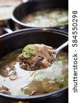 dwaeji gukbap is korea... | Shutterstock . vector #584550298