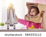 child girl in an astronaut... | Shutterstock . vector #584553112