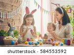 a mother and her daughter are... | Shutterstock . vector #584553592