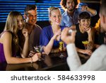 happy friends standing at... | Shutterstock . vector #584633998