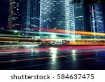 the light trails on the modern... | Shutterstock . vector #584637475