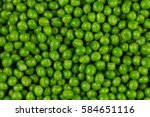 green wet raw peas vegetable... | Shutterstock . vector #584651116