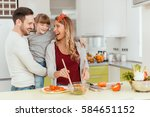 happy young family preparing... | Shutterstock . vector #584651152