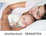 young mother with her baby in... | Shutterstock . vector #584669356