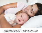 young mother with her baby in... | Shutterstock . vector #584669362