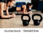 fitness girls doing plank yoga... | Shutterstock . vector #584685346