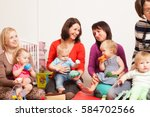 group of mothers with their... | Shutterstock . vector #584702566