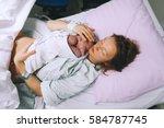 mother holding her newborn baby ... | Shutterstock . vector #584787745