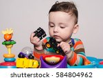 cute baby boy sitting and... | Shutterstock . vector #584804962