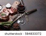 grilled ribeye beef steak with... | Shutterstock . vector #584833372