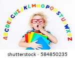 happy preschool child learning... | Shutterstock . vector #584850235