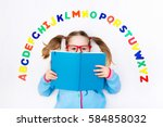happy preschool child learning... | Shutterstock . vector #584858032