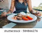 poached eggs benedict served on ... | Shutterstock . vector #584866276