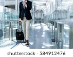 young man carrying a carry bag... | Shutterstock . vector #584912476