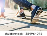 back view of young woman runner ... | Shutterstock . vector #584964076