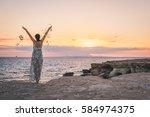 beautiful young woman staying... | Shutterstock . vector #584974375