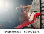 woman doing abdominal exercises ... | Shutterstock . vector #584991376