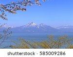 mt.bandai and inawashiro lake ... | Shutterstock . vector #585009286