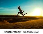 Man Jumping On White Sand Dunes