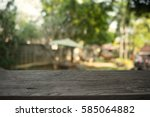 image of wooden table in front... | Shutterstock . vector #585064882