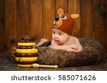 Newborn Baby In A Knitted Cap...