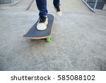 young skateboarder legs riding... | Shutterstock . vector #585088102