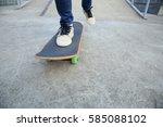 young skateboarder legs riding...   Shutterstock . vector #585088102
