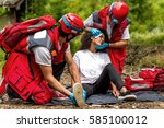rescue team helping injured... | Shutterstock . vector #585100012