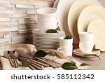 Set of rustic dinnerware on light brick background