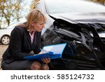 female loss adjuster writing... | Shutterstock . vector #585124732