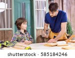 portrait of father teaching... | Shutterstock . vector #585184246