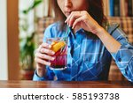 woman drinking cocktail... | Shutterstock . vector #585193738