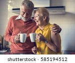 senior drink tea coffee kitchen ... | Shutterstock . vector #585194512
