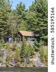 cottage on canoe lake in... | Shutterstock . vector #585195166