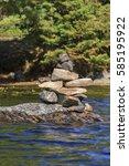 inukshuk standing on a rock on... | Shutterstock . vector #585195922